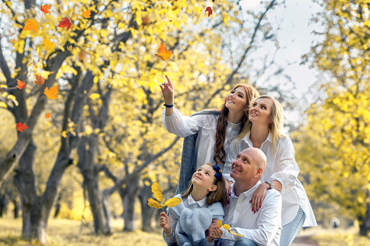 Happy weekend with daughters in autumn park